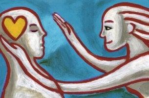 Gestalttechniken - Frau legt ihre Hand über den Kopf eines Mannes, in dem ein Herz schlägt