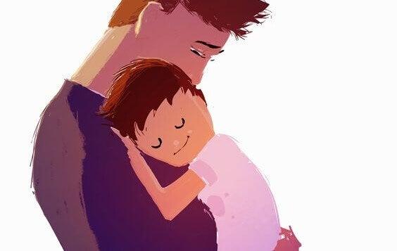 Vater hält seinen Sohn im Arm