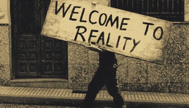 """Plakat mit der Aufschrift """"Willkommen in der Realität"""""""