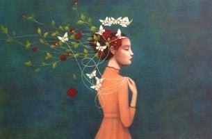 Obwohl wir eigentlich traurig sind - Frau mit Blumen und Schmetterlingen im Haar