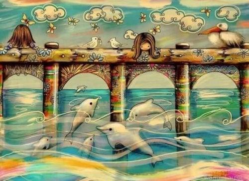 Kinderträume - Mädchen, die Delfine von einer Brücke aus betrachten