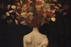 Traurigkeit überwinden - Frau mit bunten Blättern im Haar