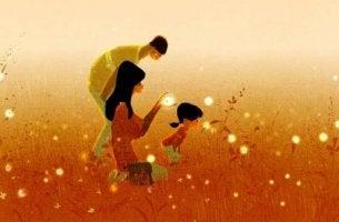 Familiäre Beziehungen - Familie im Feld mit Glühwürmchen