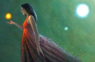 Zeit umarmen - Frau hält Licht in der Hand