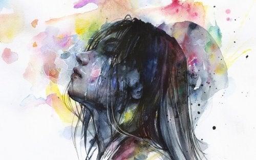 Zeichnung einer jungen Frau mit Sorgen inmitten von Farbklecksen