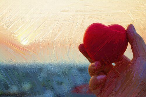 Hand hält Herz