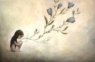 Neigung zur Unsicherheit - Mädchen kauert am Boden, aber von ihrer Position aus wachsen Blumen