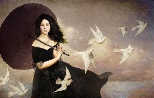 Frau mit Schirm und Vogelschwarm