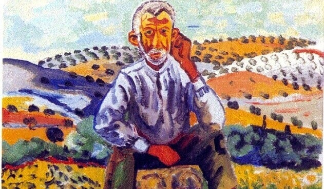 Mann sitzt im Feld
