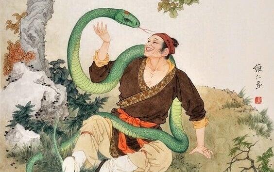 Asiatischer Mann mit Schlange