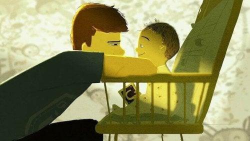 Baby im Kinderstuhl und Papa