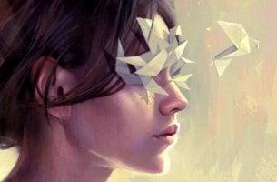 Emotionen verarbeiten - Frau mit Papiervögeln vor den Augen