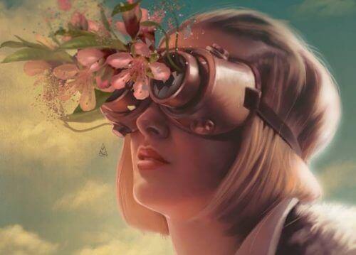 Frau mit Schutzbrille, die mit Blumen bestückt ist