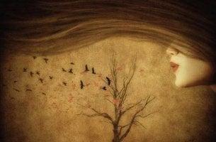Mädchen, das Baum anhaucht