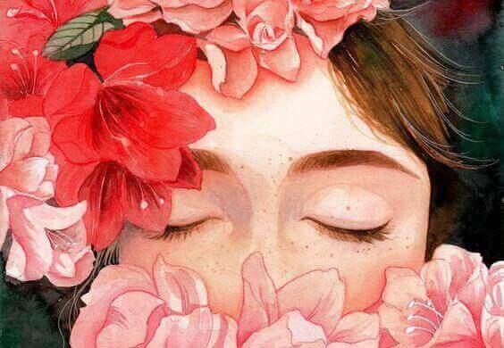 Frau mit geschlossenen Augen inmitten von Blumen