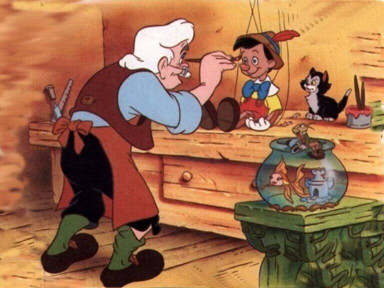 Geppetto bemalt seine Puppe Pinoccio