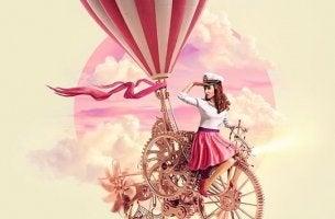 Gewohnheiten von erfolgreichen Menschen - Mädchen auf einem Fahrrad mit Heißluftballon