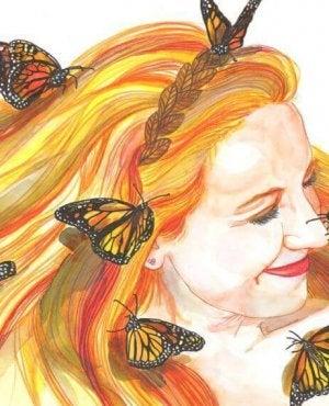 Die Macht des Lächelns - lächelnde Frau mit Schmetterlingen