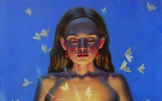 Eine Frau träumt inmitten von Schmetterlingen.