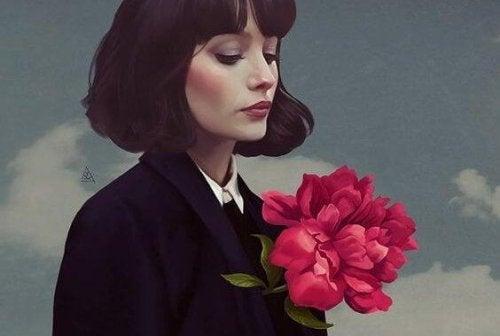 Frau, aus der eine Blume wächst