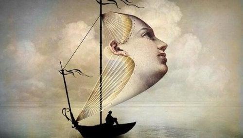 Boot mit einem Segel, das die Form eines Gesichts hat