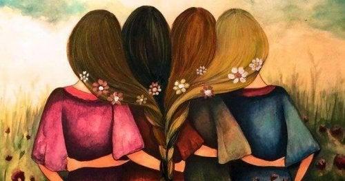 Gruppe von Frauen, deren Haare miteinander verflochten sind