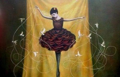 Eine Ballerina mit Vögeln