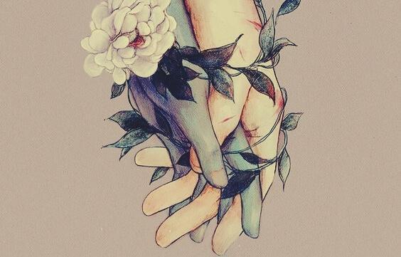 Hände umschließen sich umgeben von Blumen