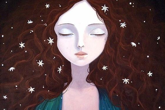 Frau mit geschlossenen Augen und Sternen in den Haaren