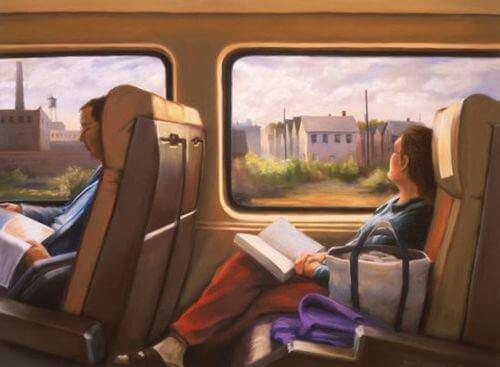 Frau mit Buch schaut aus dem Zug