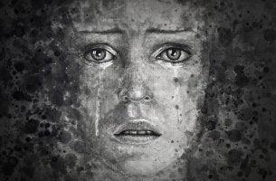 Die Depression ist eine psychische Störung - Frau mit Depression weint