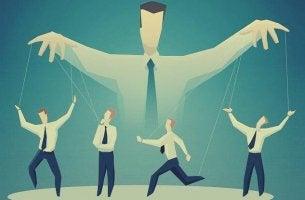 Manipulation der Gesellschaft - Marionetten tanzen