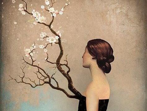 Zweig mit Blumen wächst aus einer Frau