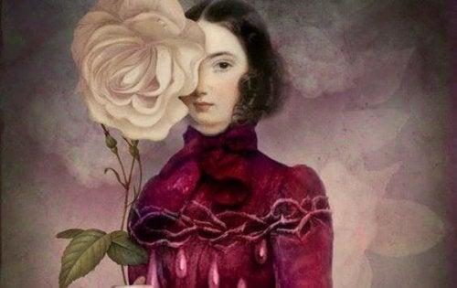 Positive Eifersucht - Frau, die ihr Gesicht hinter einer Blume versteckt