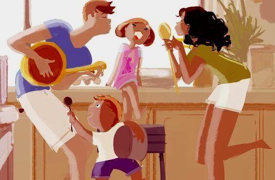 Familie lacht und tanzt zusammen daheim