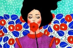 Engagierter Mensch - Frau hält sich eine rote Blume vor den Mund