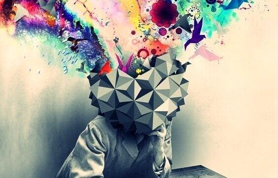 Mensch mit eckigem Kopf, aus dem bunte Farben kommen