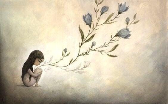 Entwicklungsphasen nach Erikson - sitzendes Mädchen mit Blumen