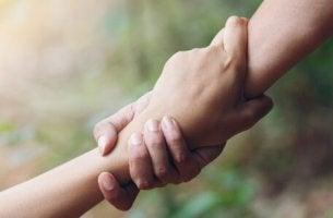 Messias-Falle - Zwei sich haltende Hände