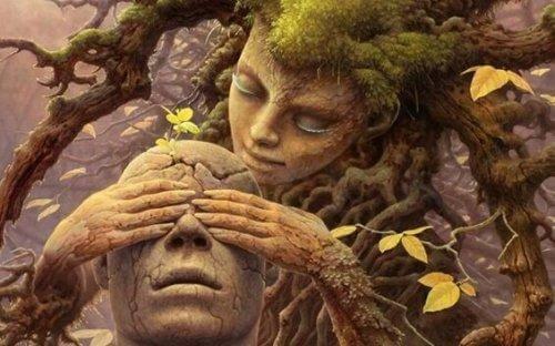 Baumfrau, die ihre Hände auf die Augen eines Mannes legt