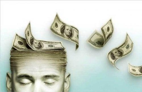 Kopf, der aus Geldscheinen besteht