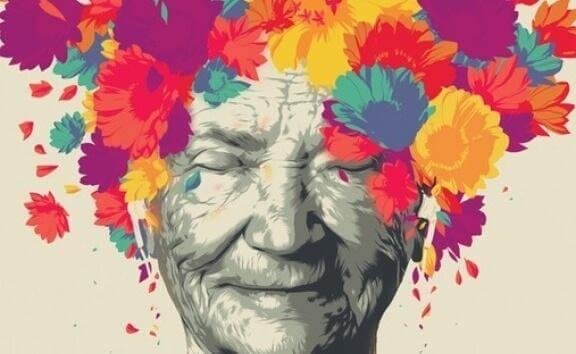 Ältere Frau umgeben von bunten Blumen