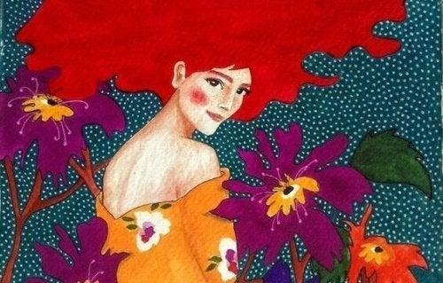 Mädchen mit roten Haaren zwischen Blumen