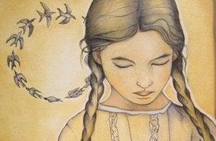 Einem Kind vom Tod erzählen - trauriges Mädchen mit Vögeln