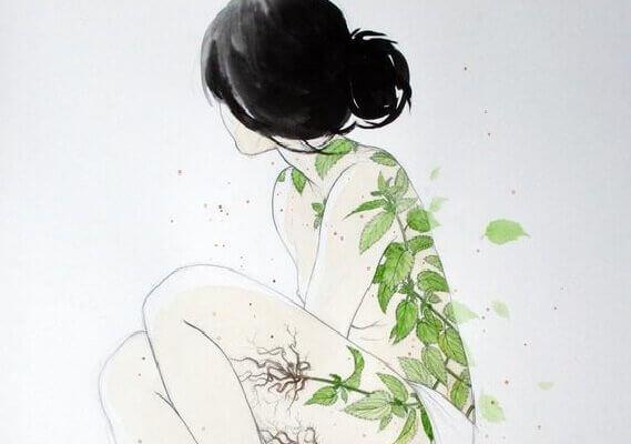 Frau mit Pflanzen auf der Haut