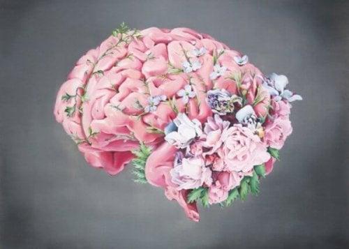 Eine Zeichnung eines Gehirns, umrankt von Blumen
