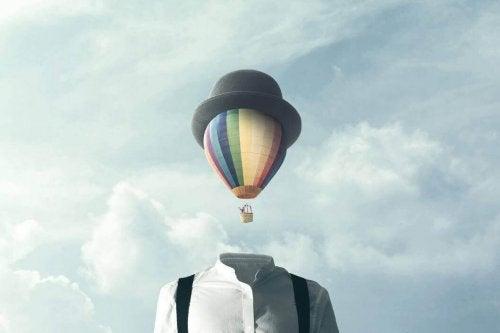 Mann mit Ballon als Kopf