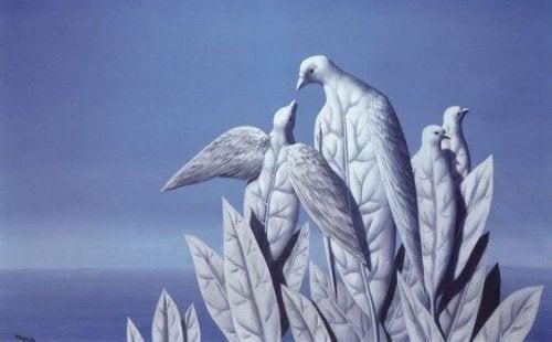 Bild, das Vögel zeigt, die aus Blättern gemacht zu sein scheinen.