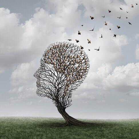 Vögel, die auf einem Baum sitzen, der die Form eines Kopfes hat.