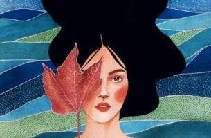 Frau mit Laubblatt, symbolisch für die Eigenschaften von emotional starken Menschen